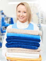 Smiling woman carrying towels