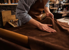 man working on a leather